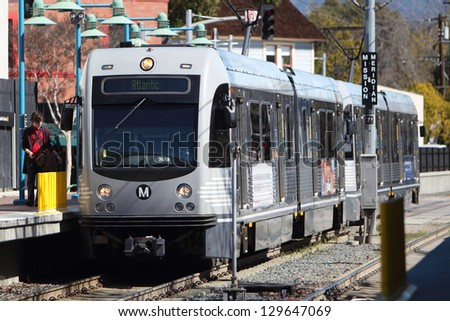 SOUTH PASADENA, CA - FEBRUARY 25 : A Gold Line AnsaldoBreda P2550 train enters Mission Station in South Pasadena on February 25, 2012.  The train seats 76 people and has a top speed of 65 mph.