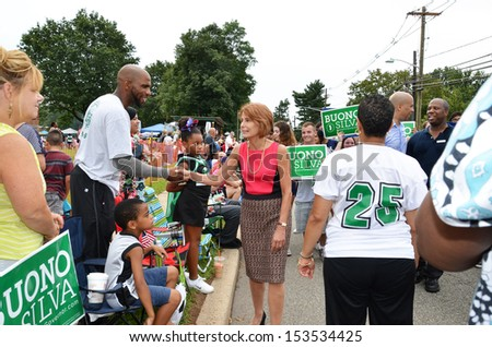 SOUTH PLAINFIELD,NJ-SEPTEMBER 2: Gubernatorial Candidate Senator Barbara Buono greets a parade-goer during the 56th Annual Labor Day Parade on September 2,2013 in South Plainfield,N.J. - stock photo