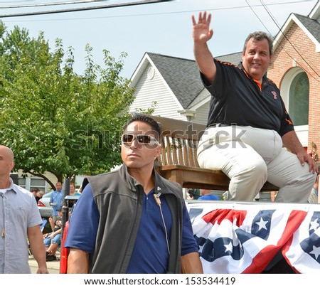 SOUTH PLAINFIELD,NJ-SEPTEMBER 2: New Jersey Governor Chris Christie waves to parade-goers during the 56th Annual Labor Day Parade on September 2,2013 in South Plainfield,N.J. - stock photo
