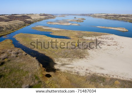 South Saskatchewan River seen from above on the Canadian prairies. - stock photo