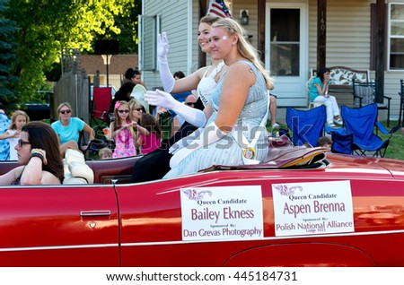 SOUTH ST. PAUL, MINNESOTA - JUNE 24, 2016: Kaposia Days Festival Queen Bailey Ekness (back) and Princess Aspen Brenna (front) wave to crowd in annual South St. Paul Grande Parade on June 24.  - stock photo
