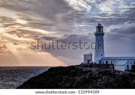 South Stack Lighthouse sunset Isle of Anglesey North wales UK - stock photo