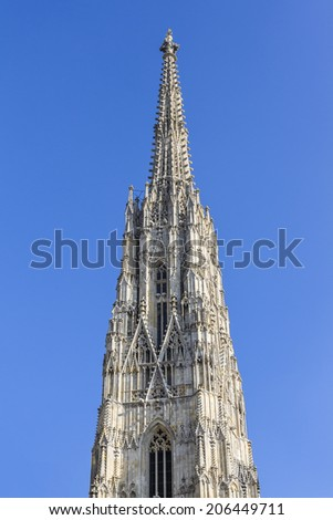 South tower of St. Stephen's Cathedral (Stephansdom) in Vienna, Austria. Cathedral is mother church of the Archdiocese of Vienna and the seat of the Archbishop of Vienna. - stock photo