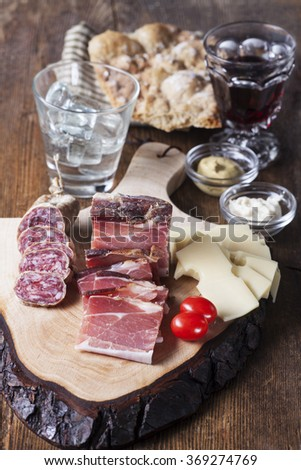 south tyrolean specialites on wood  - stock photo