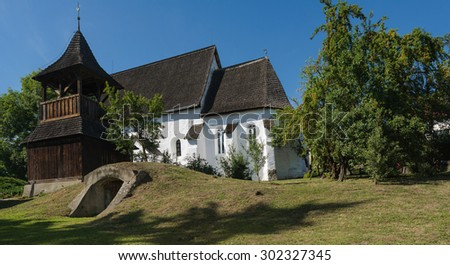 South view of the reformed church in Zubogy, North-east Hungary, during summer