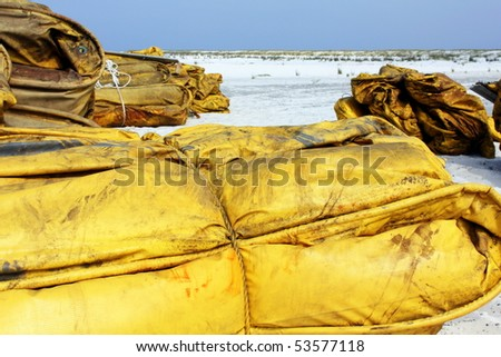 SOUTH WALTON BEACH, FL - MAY 9: Containment boom on white sand beach ready for oil spill cleanup May 9th, 2010, on South Walton Beach, FL. - stock photo