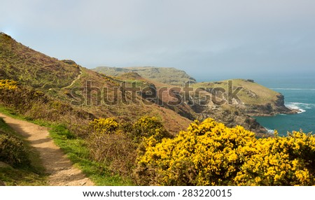 South West Coast Path along cliffs and headlands jutting into the sea near Tintagel, Cornwall, England, UK - stock photo