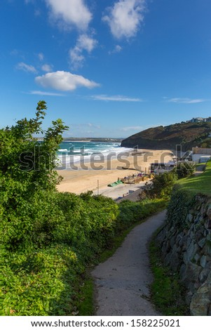 South West Coast Path Carbis Bay Cornwall England near St Ives with a sandy beach on a beautiful sunny day  - stock photo