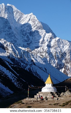 South West view of a Tibetan Buddhist Chorten with crystal clear view of Mt Thamserku behind as seen from Dingboche, along trek route to Everest Base Camp, Khumbu, Nepal. - stock photo