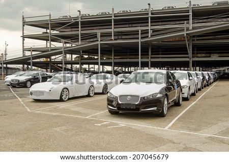 SOUTHAMPTON, UK - MAY 31, 2014:  Rows of newly-built Jaguar cars parked at Southampton docks before being exported. - stock photo
