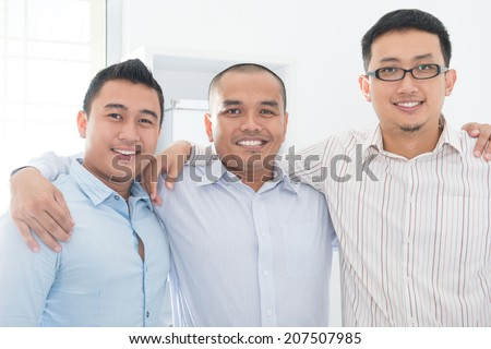 Southeast Asian business team in office. - stock photo