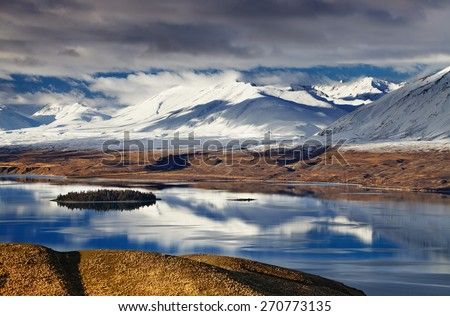 Southern Alps and Lake Tekapo, view from Mount John, Mackenzie Country, New Zealand - stock photo