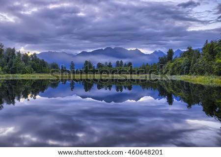 Southern Alps reflected in Lake Kaniere, South Island, New Zealand
