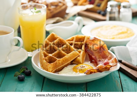 Southern cuisine breakfast with waffles, bacon and egg - stock photo