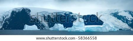 Southern Orkney Islands in antarctic area. Island and icebergs. - stock photo