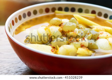 Southern sour soup with fish and mangosteen - stock photo