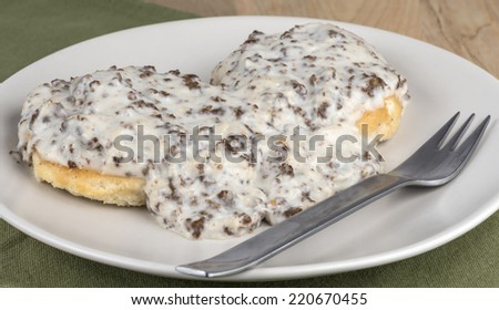 Southern style sausage gravy  and biscuits - stock photo