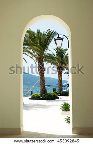 Southern summer landscape through the arch - stock photo