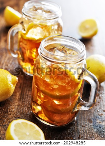 southern sweet tea in a rustic jar - stock photo