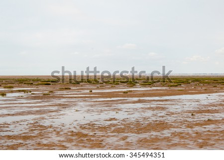 Southport Beach during low tide. Overcast weather. - stock photo
