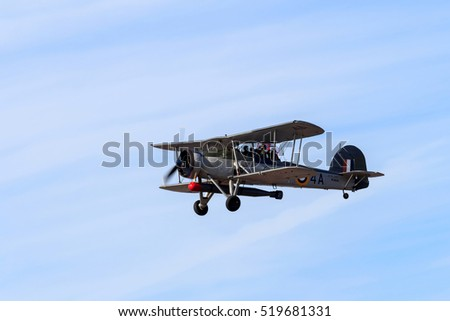 SOUTHPORT, ENGLAND, SEPTEMBER 19, 2015, Royal Navy Fairey Swordfish biplane with two air crew saluting on fly past at the airshow