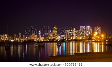 Southport, Gold Coast, Queensland, Australia. Night cityscape light reflected in broad-water  - stock photo