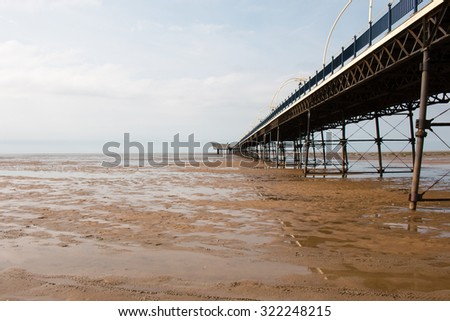 Southport Pier during low tide. - stock photo