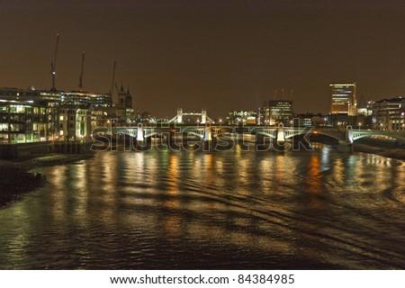 Southwark bridge across River Thames at London - stock photo