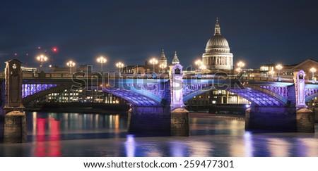 Southwark Bridge and St.Pauls Cathedral at night - stock photo
