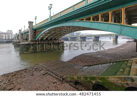 Southwark Bridge Over Low Tide River Thames in London