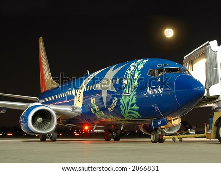 "Southwest Airlines airplane ""Nevada One"" at the gate at night - stock photo"