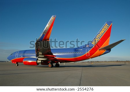 Southwest Airlines plane on the tarmac with blue sky - stock photo
