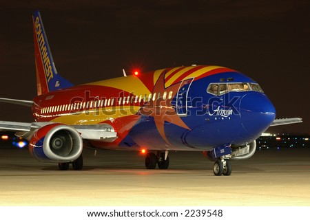 Southwest Airlines plane with Arizona flag taxiing at night - stock photo