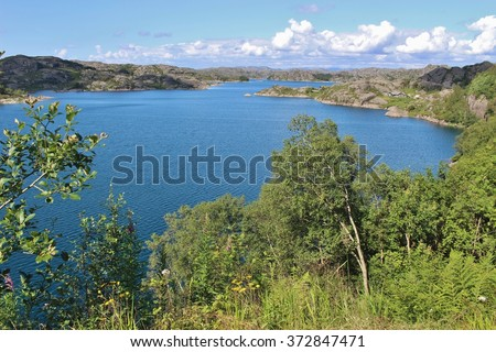Southwest Norway, Europe, near Eigeroya. A beautiful and varied coastal landscape with many small islands, reefs and skerries. - stock photo