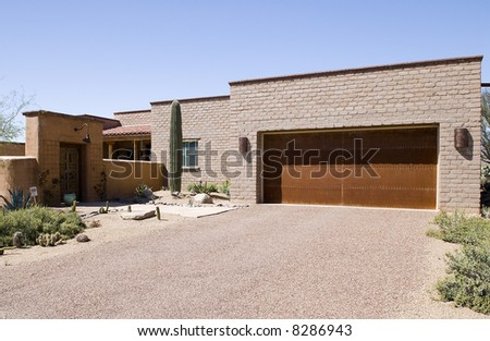 Southwestern home constructed of adobe blocks. - stock photo