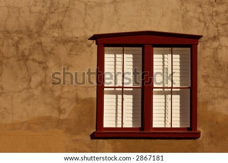 Southwestern style adobe window in historical part of Tuscon, Arizona - stock photo
