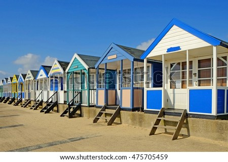 Southwold beach chalets on a sunny summer day