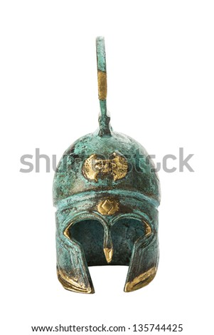 Souvenir ancient brass greek helmet with green over white - stock photo
