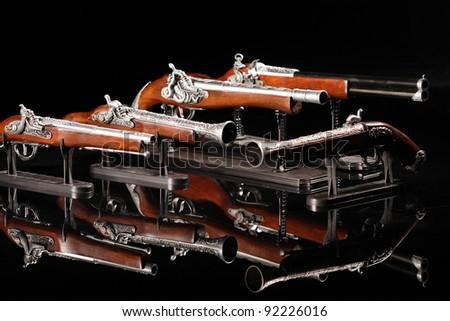 Souvenir antique pistols in an interesting photocomposition - stock photo