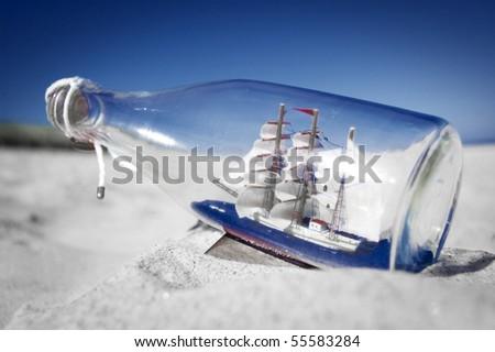 Souvenir conceptual image. Ship in a bottle. - stock photo