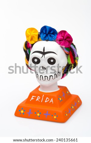 Souvenir of famous mexican artist Frida Kahlo in a form of a skull in a colorfull wreath   - stock photo