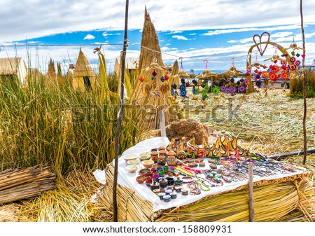 Souvenir on Floating islands Titicaca lake, Peru,South America. Street shop with colorful blanket, scarf, cloth, ponchos,ornaments, - stock photo