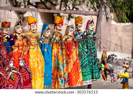 Souvenir Rajasthan puppets hanging in the shop of Jodhpur City Palace, India    - stock photo