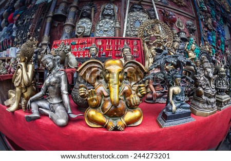 Souvenir statues of Ganesh, Buddha and other goddess in the shop of Kathmandu, Nepal    - stock photo