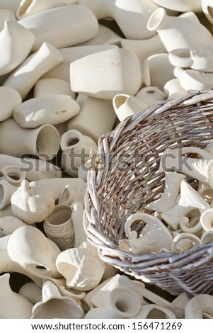 Souvenirs made of clay before coloring in the pottery workshop. - stock photo