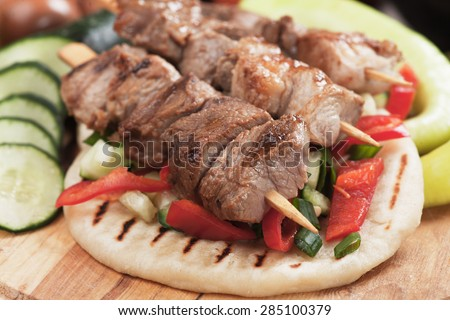 Souvlaki or kebab, grilled meat skewer and pita bread - stock photo