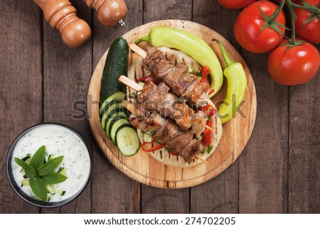 Souvlaki or kebab, meat skewer with pita bread and fresh vegetable - stock photo