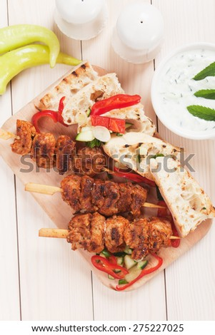 Souvlaki or kebab, meat skewer with toasted bread and fresh vegetable