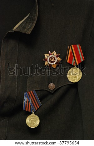 Soviet awards on military uniform - stock photo