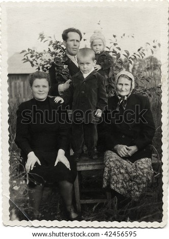 Soviet family. Man with a wife and an old woman (grandmother), and with their children: a boy and girl USSR, mid 20 century